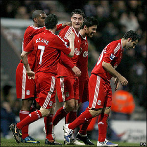Albert Riera is congratulated by his Liverpool team-mates
