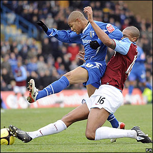 Simeon Jackson is tackled by Villa's Zat Knight