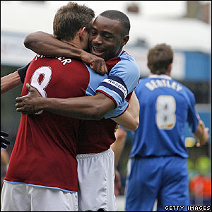 Villa's  James Milner is congratulated by Nigel Reo-Coker