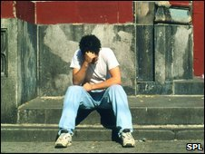 Depressed youth sitting on steps