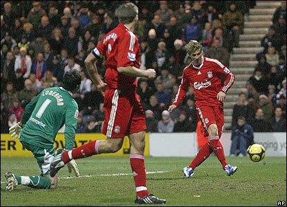 Fernando Torres scores on his return to the Liverpool side