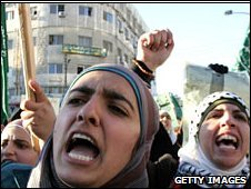 Supporters of Jordan's Muslim Brotherhood group shout anti-Israel slogans at a rally outside parliament in Amman against Israel's attacks on Gaza on January 4, 2009