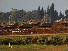 Israeli tanks stand massed in a field while preparing to enter Gaza January 4, 2009 outside of Sderot, Israel