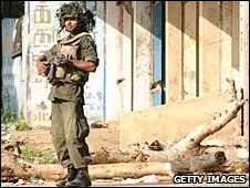 A Sri Lankan soldier patrols the Tamil Tiger political capital town of Kilinochchi, some 330 kilometers (202 miles) north of Colombo on January 4, 2009