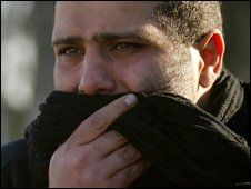 An Iranian pilgrim weeps after the attack in Baghdad