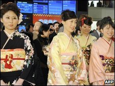 Women in Kimono smile at a ceremony to open the Tokyo Stock Exchange on 5 January