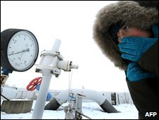 A woman looks at a meter on a gas pipe at a gas-compressor station in Boyarka, near Kiev, Ukraine, 4 January 2009