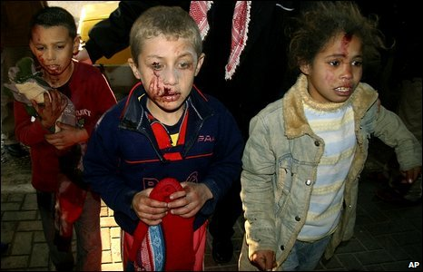 Wounded Palestinian children arrive for treatment at Shifa Hospital in Gaza City, 5 January 2009