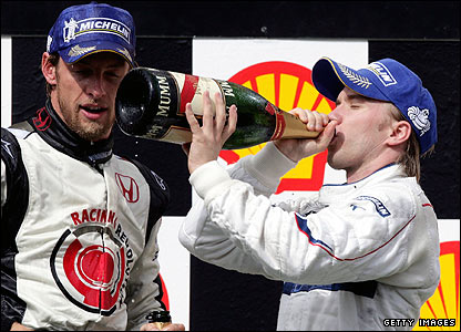Nick Heidfeld (right) celebrates his third at the 2006 Hungarian Grand Prix with race winner Jenson Button