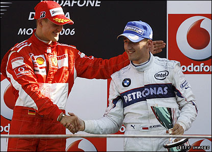 Michael Schumacher (left) congratulates Robert Kubica on his third place at the 2006 Italian Grand Prix