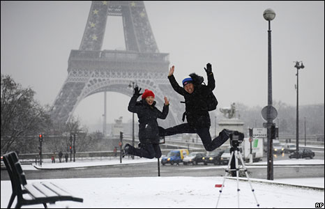 Tourists jump in front of the Eiffel Tower, Paris, 5 January 2008
