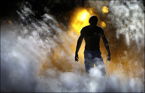 Acrobat emerging from smoke and lights at Sydney Opera House, 5 January 2008