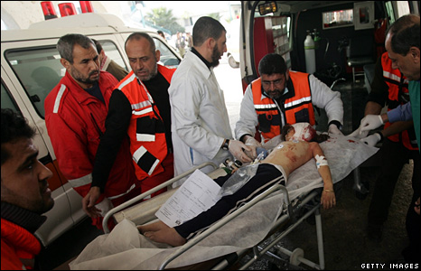 A wounded Palestinian girl is rushed to Gaza's Shifa hospital