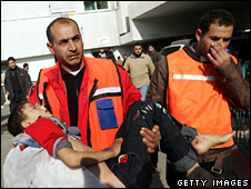 A wounded child is carried into a hospital in Gaza City (5 January 2009)