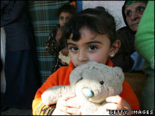 A little girl takes shelter at a UN aid centre in Gaza on 5 January 2009