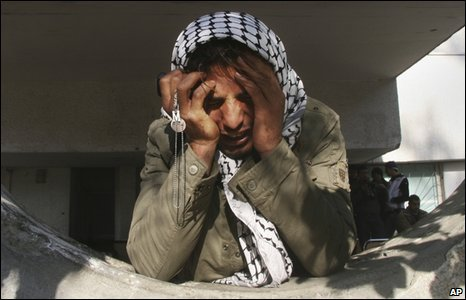 A Palestinian man holds his head in his hands at the Shifa Hospital in Gaza City, 5 January 2009