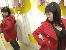 Chinese woman tries on clothing