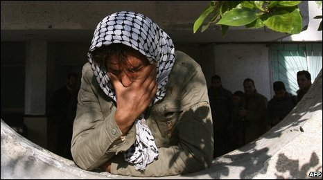 A Palestinian man mourns for his family