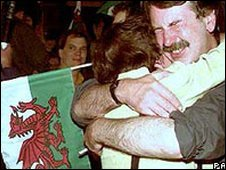 Yes campaigners celebrate their narrow victory early on 19 Sept, 1997