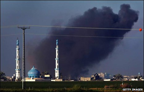 Smoke rises from behind a mosque inside the Gaza Strip, 6 January