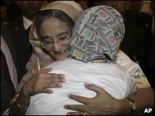 Sheikh Hasina hugs an unidentified friend after the swearing-in
