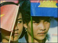 Cambodian school children with Cambodian and Vietnamese flags in 1989