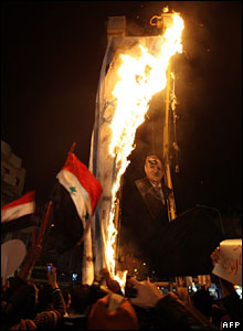 Syrian students burn a huge Israeli flag and a picture of Israeli Defence Minister Ehud Barak at a protest against Israel's Gaza offensive, 6 Jan 2009