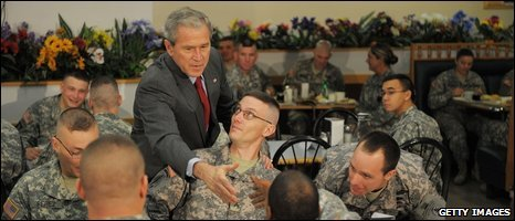 George W Bush greets troops