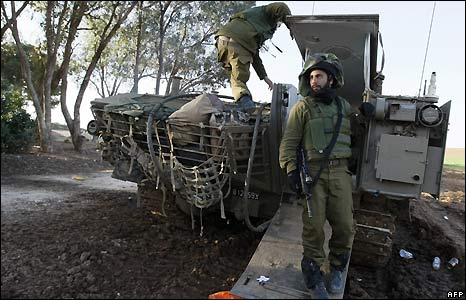Israeli soldiers on armoured personnel carrier on the border with Gaza
