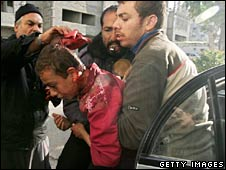 A wounded Palestinian youth is taken to hospital in Gaza City