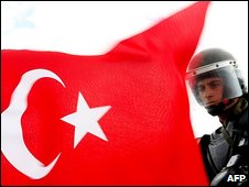 Policeman and Turkish flag