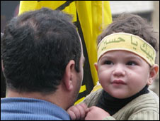Hezbollah supporter with a child in Beirut