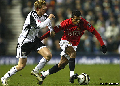 Derby's Paul Green (left) tussles with Man Utd's Nani