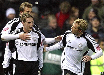 Derby celebrate after Kris Commons puts them 1-0 up against Manchester United
