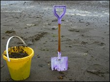 Bucket and spade on a beach