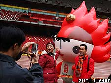 Crowds of tourists visit the National Stadium in Beijing