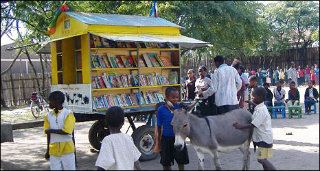 A donkey in front of the mobile library