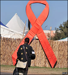 A man walks past a giant Aids symbol at a conference on Aids and sexually transmitted infections in Africa in Senegal in December 2008