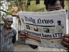 Sri Lankan newspaper reader