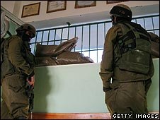Israeli soldiers in a Palestinian house