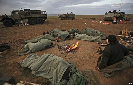 Israeli soldiers sleep on the Israeli-Gaza border on 8/1/09