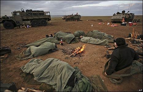 Israeli soldiers sleep on the Israeli-Gaza border on 8/1/09