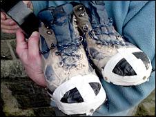 Ieuan Butler's taped up work boots