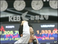 A South Korean currency trader in the Korea Exchange Bank on Thursday