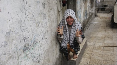 Palestinian girl reacts after Israeli military air strike