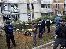 Israeli police in Sderot inspect damage after a rocket was fired from the Gaza Strip