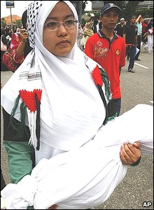 Woman takes part in protest in Malaysia