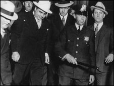 Capone in the white hat, with US Marshals