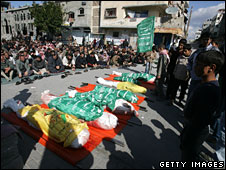 The funeral takes place of seven members of a Palestinian family killed in Gaza, 9 Jan