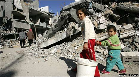 Palestinian children walk past rubble in Jabaliya, Gaza, on 9 January 2009